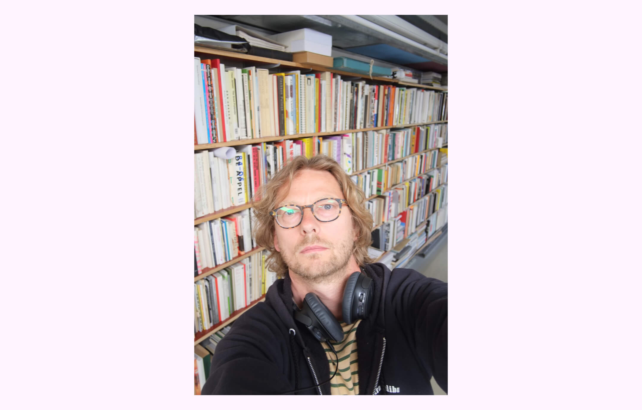 A self-portrait taken by Roger Willems in his Amsterdam studio, set on a pink background