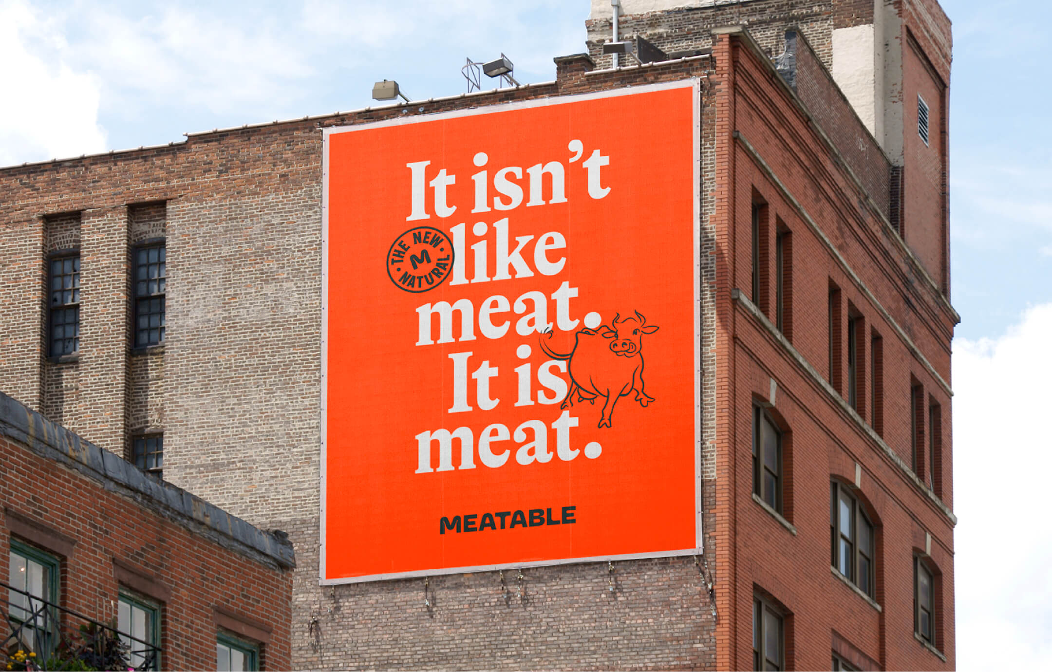 "Billboard on the side of a building that reads ""It isn't like meat. It is meat."""