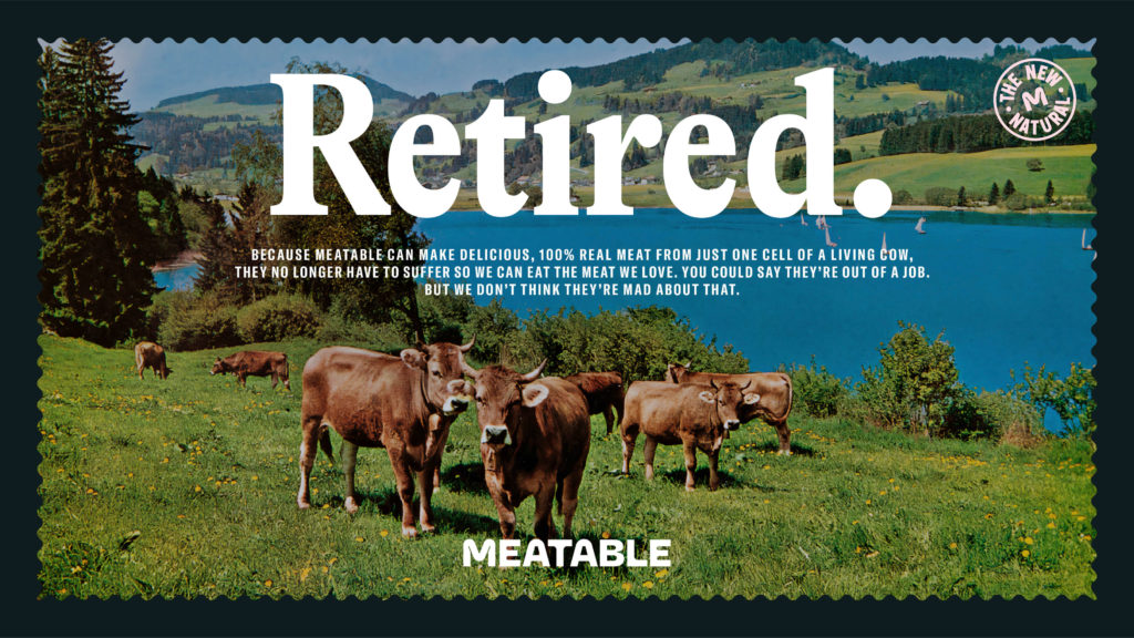 """Image of cows on a grassy hill in front of a lake. Above them is the word """"Retired."""""""