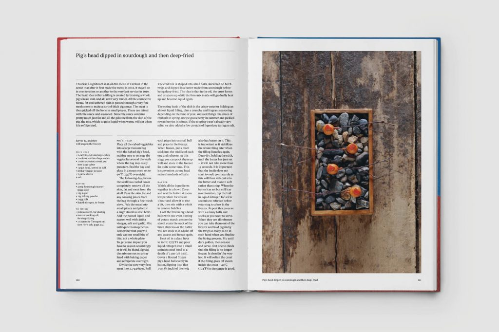 Spread from Faviken, a cookbook published by Phaidon. On the left-hand page, the text of a recipe; on the right, a photograph depicting what look like fruits impaled on twigs resting in an open-topped box of stones.