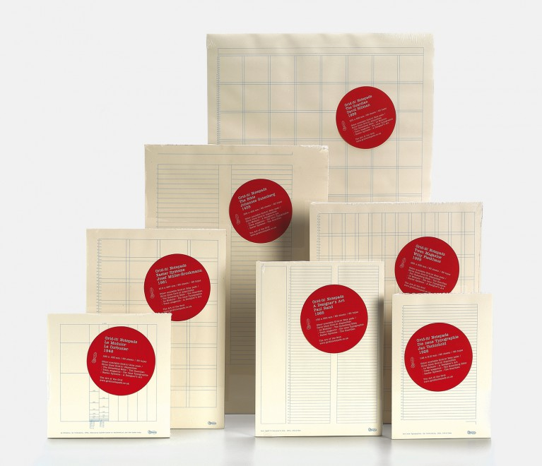 Seven notepads from Astrid Stavro's Art of the Grid project. Featuring paper in various sizes, each sheet is printed with a lightly colored grid. Each package features a bright red circular sticker with text on it.
