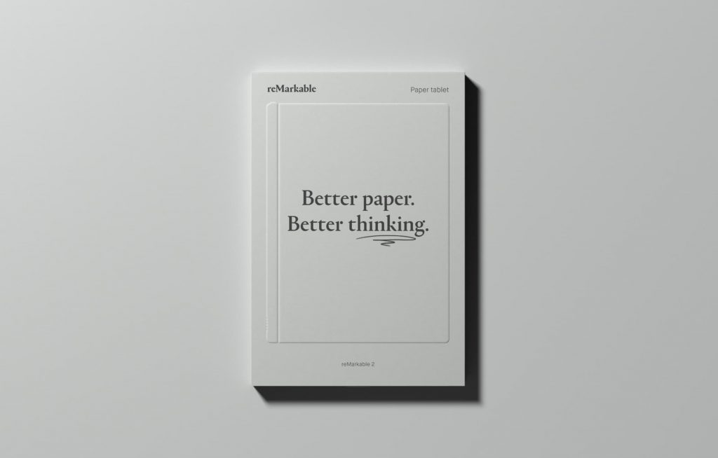 "A rectangular gray package with a minimal design features the text ""Better paper. Better thinking."" The package rests on a similarly gray background."