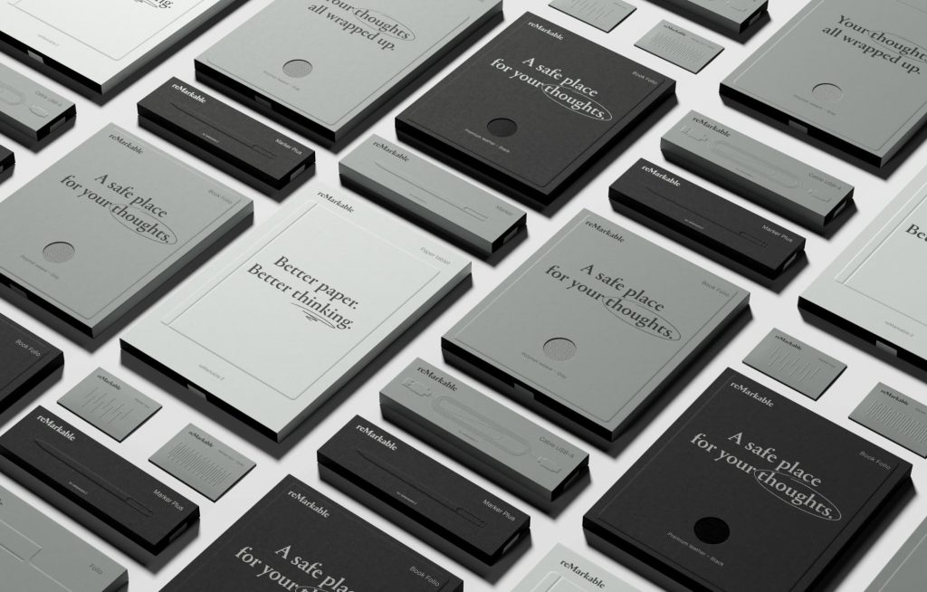Photo depicting the full range of reMarkable packaging in shades of gray. These minimal rectangular packages feature embossed highlights and black text.