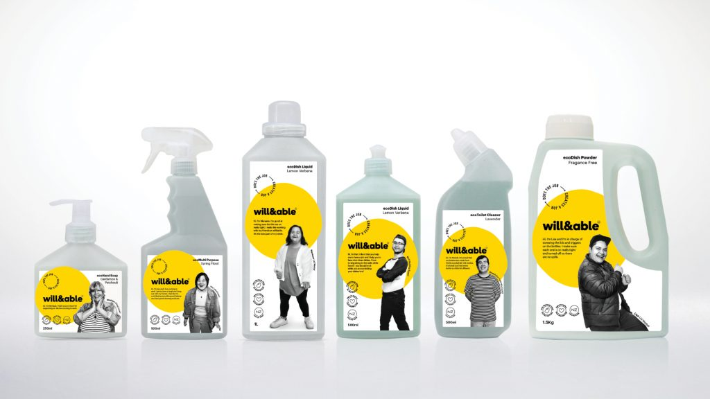 Six bottles of cleaning products produced by Will & Able; each label features a large yellow circle, friendly sans-serif black type, and a black-and-white portrait of one of the company's differently abled employees